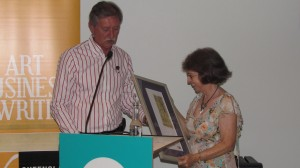 Sandy receiving her award from the chair of the QWC,